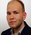 Patryk Słowik, dziennikarz Gazety Prawnej
