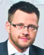 Łukasz Chruściel radca prawny kierujący biurem kancelarii Raczkowski Paruch w Katowicach