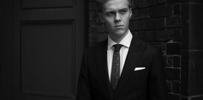 Jakub Gierszał jako Michael, prawnik z Berlina